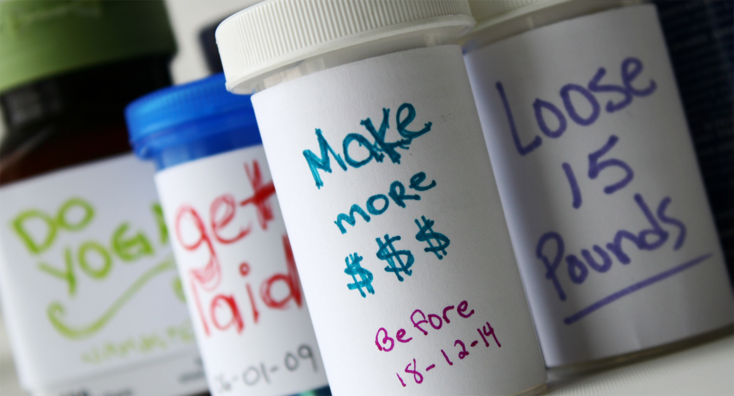 Pill bottles with goals for labels